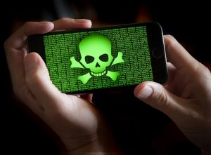 iphone with skull on it representing hackers