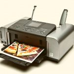 A picture of pizza coming out of a printer